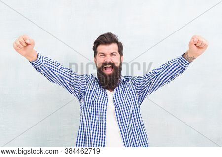 Happy Bearded Man Celebrate Victory Keeping Arms Upward Fingers Clenched Winning Gestue Blue Backgro