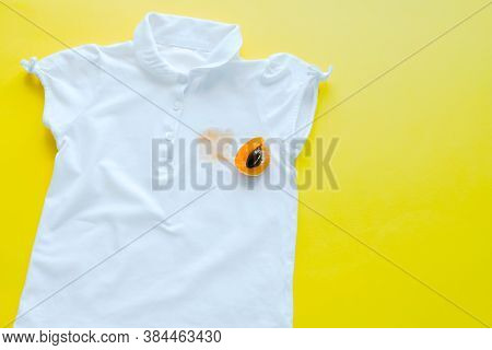 Stain From Fruit On A T-shirt. Daily Life Dirty Stain For Wash And Clean Concept