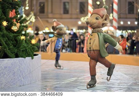 St. Petersburg, Russia - December 14, 2019: Statue of skating mouse on the New Year and Christmas Fair on Manege square. More than 20 statues of mouses symbolizing the Chinese year of mouse