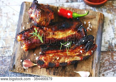Baked Meat Ribs. Appetizing Hot Ribs Baked In Honey Mustard Sauce With Chili Pepper. Bbq Ribs.