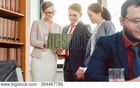 Very international lawyers of in-house legal department working and discussing