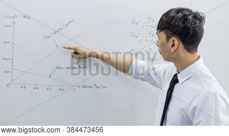 Teacher is teaching physics to students during the new school days after a long break, High school s
