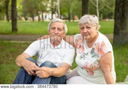 Old Man And Attractive Old Woman Are Enjoying Spending Time Together. Mature Senior Couple Having Fu