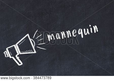 Chalk Drawing Of Loudspeaker And Handwritten Inscription Mannequin On Black Desk