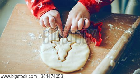 Christmas Preparation Of A Young Kid Making Cookies At Home Wearing Red Sweater