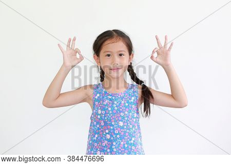 Cheerful Asian Little Kid Girl Showing Finger Ok Symbol Sign Language Isolated Over White Background