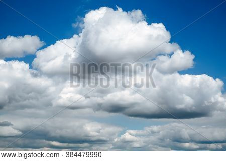 Blue Clear Sky With White Fluffy Clouds. Natural Background.