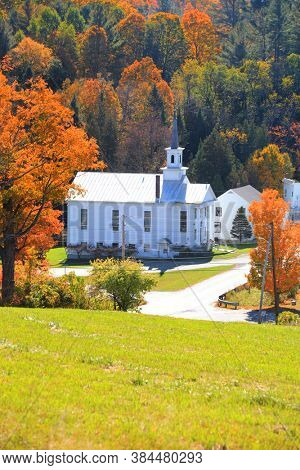 Historic church in West Barnet village in Vermont during autumn time