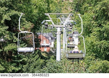 Vianden, Luxembourg - July 22, 2020: People On A Chair Lift In Vianden, A Town In Luxembourgs Ardenn
