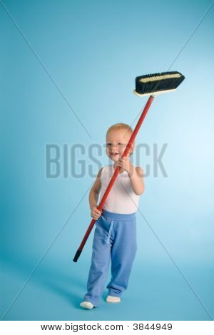 Joyful Boy With Cleaning Swab Over Blue