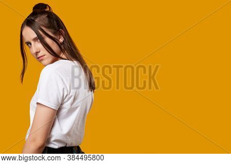 Upset Girl. Bad Emotion. Sad Young Woman Looking Frowningly. Isolated On Orange Copy Space. Teasing