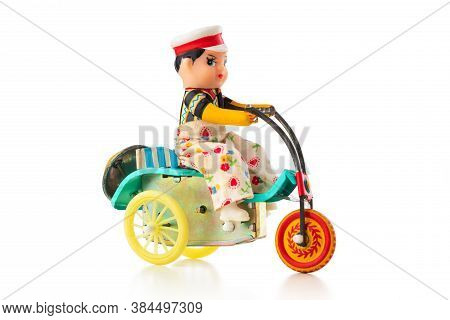 A Child Old Vintage Toy Of A Chinese Man With Bicycle