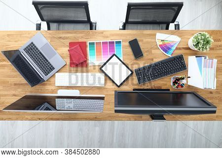 Workplaces In Office Table Chairs Tablet Smartphone Color Palette Pencils Tablet Keyboard Monitors.