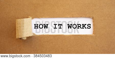 Text How It Works Appearing Behind Torn Brown Paper.