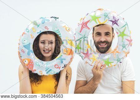 Happy Girl With A Boy Isolated On White Background Holding Life Preservers.