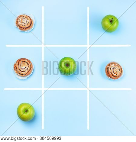 Green Apples Vs Cinnamon Buns In Tic Tac Toe Or Noughts And Crosses Game, Healthy Vs Unhealthy Food