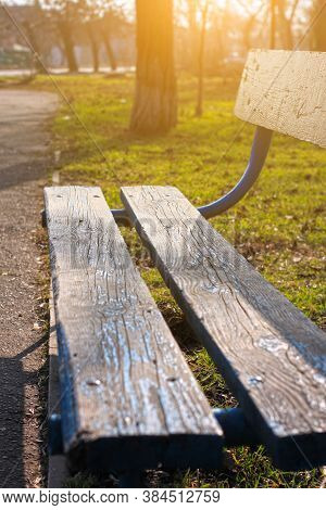 Old Wooden Park Bench Close-up On Blurred Green Nature Background. Backdrop For Text Sign, Copy Spac