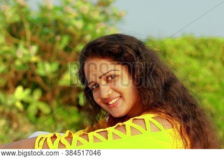Closeup Portrait Of A Happy Indian Woman With A Beautiful Face And Yellow Fancy Top, Beauty Woman Fa