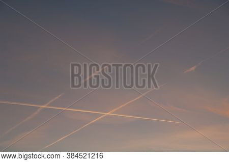 Airplane And Contrails Of Another Airplanes In The Sky.