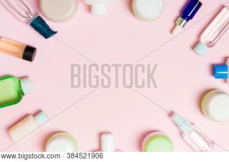 Frame Of Plastic Bodycare Bottle Flat Lay Composition With Cosmetic Products On Pink Background Empt