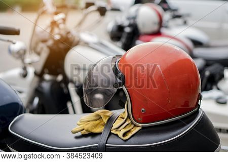 Motorbike Parking And Biker Place Helmet, Leather Jacket And Gloves On Motorcycle. Young Traveller M