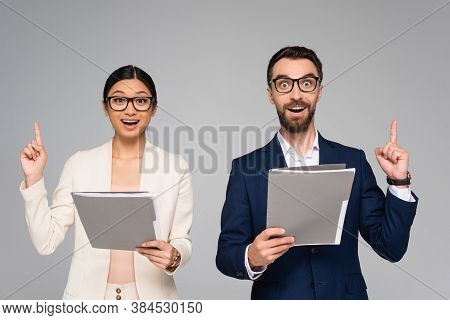 Excited Couple Of Interracial Business Colleagues Showing Idea Gesture While Holding Folders Isolate