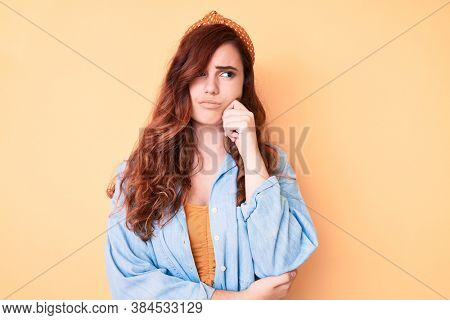 Young beautiful woman wearing casual clothes thinking concentrated about doubt with finger on chin and looking up wondering