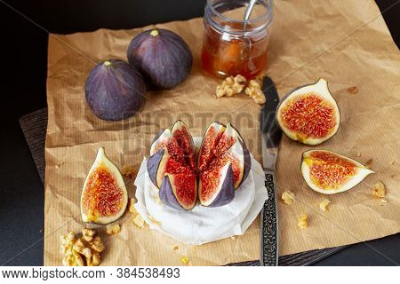 Fresh Figs With Cheese Brie, Walnuts And Jar Of Honey, Spoon On Craft Paper. Delicious Appetizer. Co
