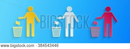 Paper Cut Man Throwing Trash Into Dust Bin Icon Isolated On Blue Background. Recycle Symbol. Trash C