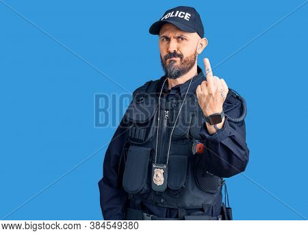 Young handsome man wearing police uniform showing middle finger, impolite and rude fuck off expression