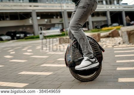 Man Riding Unicycle On Street, Electric Unicycle Close Up.