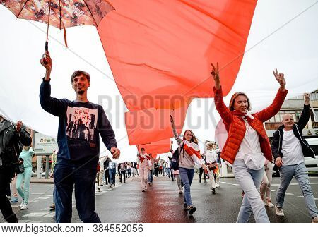 Minsk, Belarus - August 23, 2020: Belarusian People Carry Giant Historical Flag Of Belarus. They Par