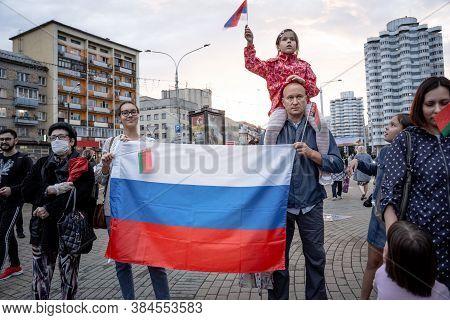 Minsk, Belarus - August 25, 2020: Belarusian People Carry Flag Of Russia In Belarus. Rally In Suppor