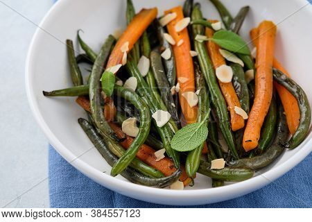 Green Beans With Carrots Cooked With Olive Oil And Sage. Healthy Food.