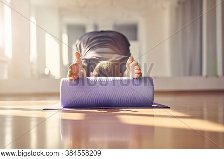 Young Man Doing Exercise With Muscle Therapy Foam Roller