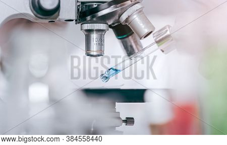 Scientist With Equipment And Science Experiments Laboratory Glassware Containing Chemical Liquid. He