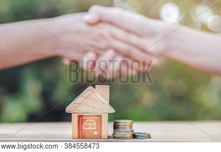 Real Estate Brokers And Clients Shake Hands After Agreeing To Buy A Home. Realty Purchase, Bank Empl