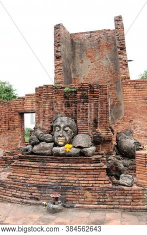 The Ruins Of Stone Buddha Pile Together In The Ruins And Ancient Church At Wat Worachet Temple, It B