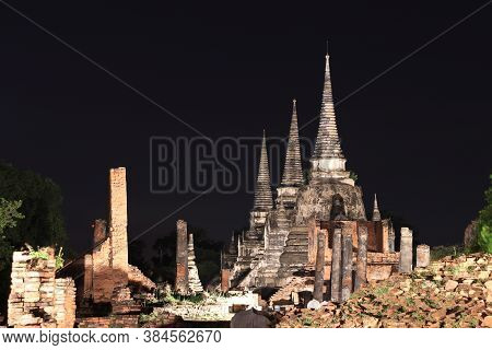 Night Shot Of The Three Main Pagoda In The Ruins Of Ancient Remains At Wat Phra Si Sanphet, It Built