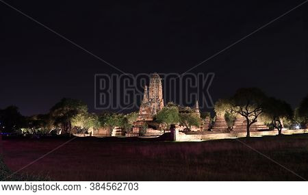 Night Shot Of The Main Phra Prang In Corn Shape And Small Stupa Around The Main In The Ruins Of Anci