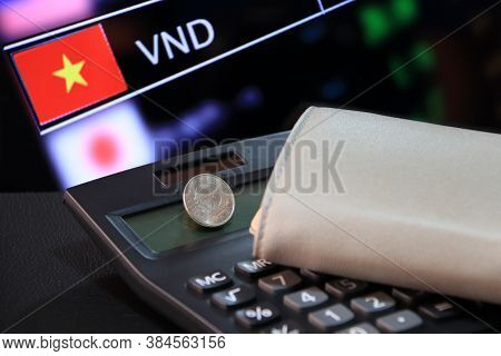 Two Hundred Vietnam Dong Coin On Obverse (vnd) On Black Calculator And Wallet With Digital Board Of