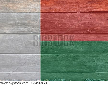Flag Of Madagascar On Wooden Wall Background. Grunge Madagascar Flag Texture, Two Horizontal Bands O