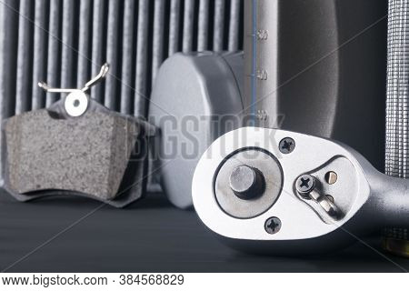 Close-up Of The Switch Button, Spanner, Against The Background Of Consumables For Car Maintenance