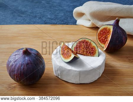 Delicious Brie Cheese With Figs On Wooden Board