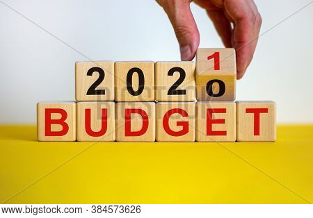 Business Concept Of Planning 2021. Male Hand Flips Wooden Cube And Change The Inscription 'budget 20