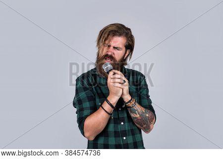 Make Voice Louder. Concept Of Music. He Is Rock Star. Brutal Stylish Singer. Singing In Karaoke. Mat