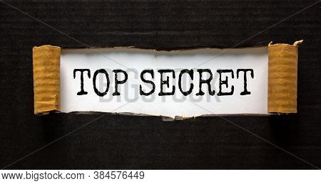 The Word 'top Secret' Appearing Behind Torn Black Paper. Business Concept.