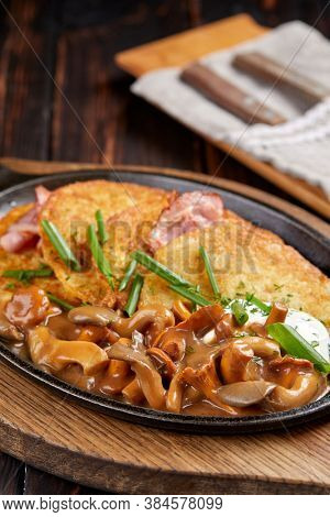 potato pancakes with mushrooms and bacon