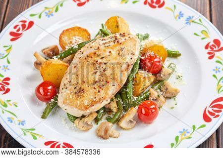 chicken fillet with fried vegetables