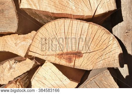 Dry Wood, Cut And Stacked, Prepared For Fuel In Winter.